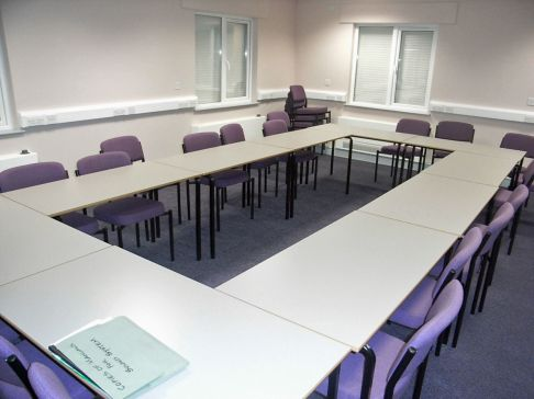 Room with tables set out for meeting